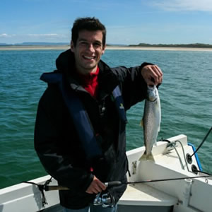 A French visitor with a sea trout caught on a fantastic day.  June 2010.