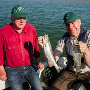 A father and son from Germany who, despite very difficult fishing, took these two fine trout. September 2014.