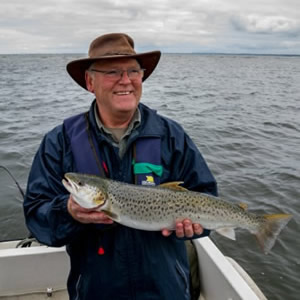 An English visitor with a beautiful sea trout of 4 1/2 pounds. July 2011.